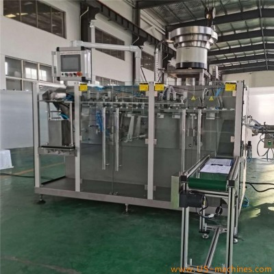 Horizontal type automatic premade stand up pouch bag liquid 2 nozzles cap filling sealing machine bag packing line
